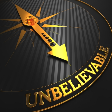 unbelievable: Unbelievable - Business Concept. Golden Compass Needle on a Black Field Pointing to the Word Unbelievable. Stock Photo
