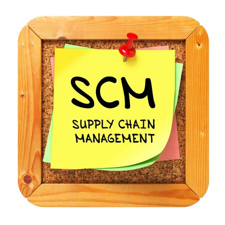 scm: SCM - Supply Chain Management - Written on Yellow Sticker on Cork Bulletin or Message Board. Business Concept.