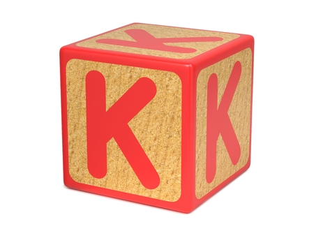 Letter K on Red Wooden Childrens Alphabet Block  Isolated on White. Educational Concept. photo