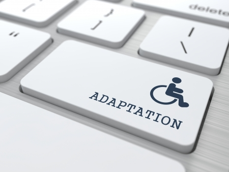 Adaptation Word with  Disabled Icon on Button of White Modern Computer Keyboard. photo