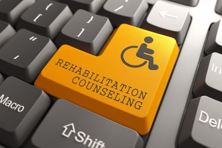Rehabilitation Counseling Words with Disabled Icon on Orange Button of Black Modern Computer Keyboard.