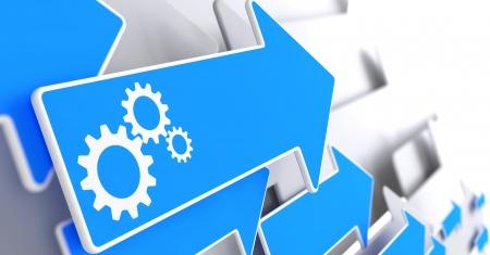 Cogwheel Gear Mechanism Icon on Blue Arrow on a Grey Background. Imagens