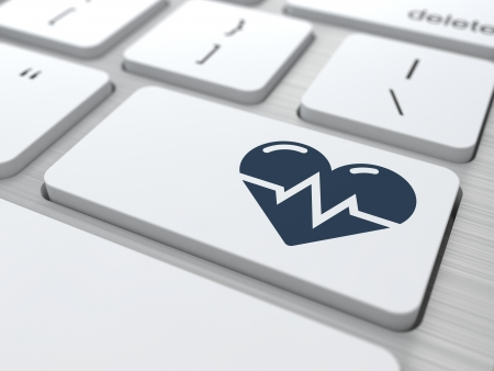 epidemiology: Button with Icon of Heart with Cardiogram Line on White Modern Computer Keyboard. Medical Concept. Stock Photo