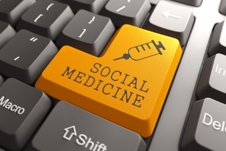 antigenic: Social Medicine Words with Syringe Icon on Orange Button on Black Modern Computer Keyboard. Medical Concept. Stock Photo