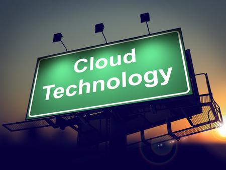 tecnology: Cloud Tecnology - Green Billboard on the Rising Sun Background.