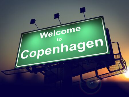 Welcome to Copenhagen - Green Billboard on the Rising Sun Background. photo