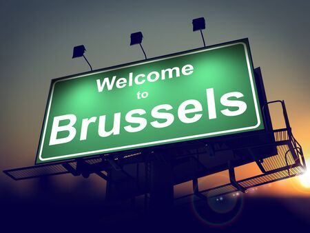 Welcome to Brussels - Green Billboard on the Rising Sun Background. photo
