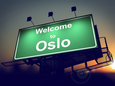 Welcome to Oslo - Green Billboard on the Rising Sun Background. photo