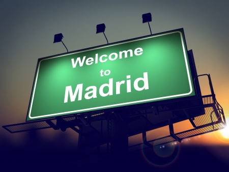 Welcome to Madrid - Green Billboard on the Rising Sun Background. photo