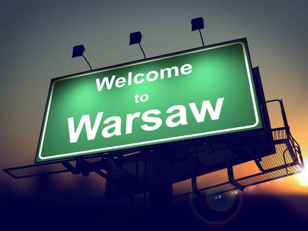 Welcome to Warsaw - Green Billboard on the Rising Sun Background. photo