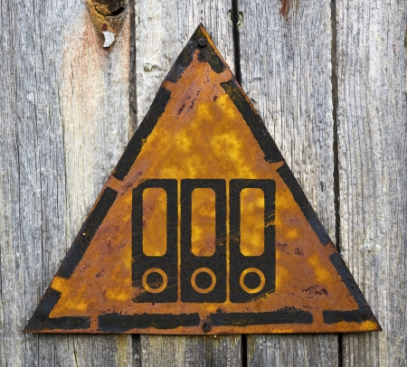 Data Concept. Folders Icon on Weathered Triangular Yellow Warning Sign. Grange Background. photo