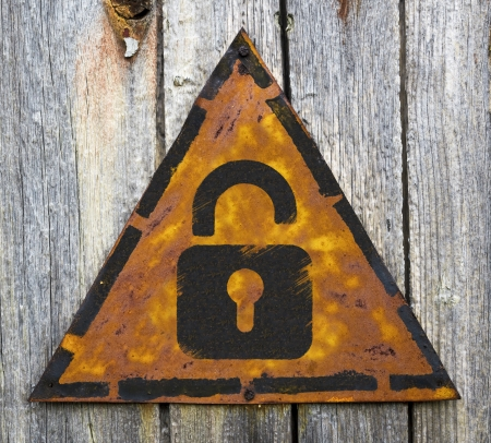grange: Security Concept. Icon of Opened Padlock on Weathered Triangular Yellow Warning Sign. Grange Background.