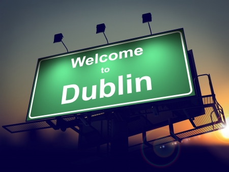 republic of ireland: Welcome to Dublin - Green Billboard on the Rising Sun Background.