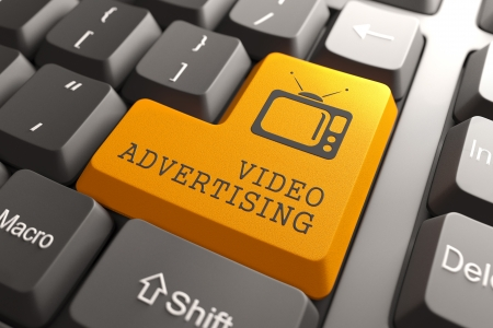 infomercial: Video Advertising - Orange Button with TV Set Icon on Black Computer Keyboard.