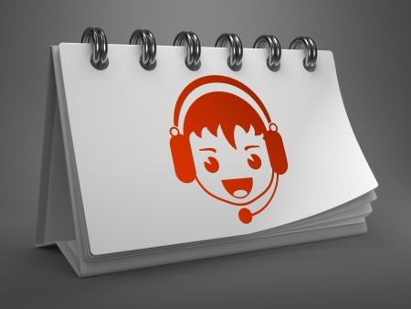 Boy with Headset Icon on White Desktop Calendar Isolated on Gray Background. Live Support, Live Chat Concept. photo
