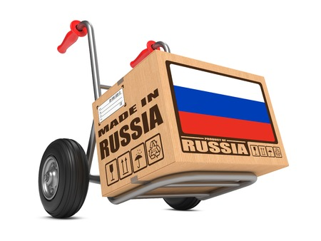 made in russia: Cardboard Box with Flag of Russia and Made in Russia Slogan. Free Shipping Concept.