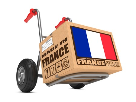 Cardboard Box with Flag of France and Made in France Slogan. Free Shipping Concept. photo
