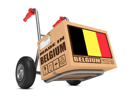 millboard: Cardboard Box with Flag of Belgium and Made in Belgium Slogan. Free Shipping Concept. Stock Photo
