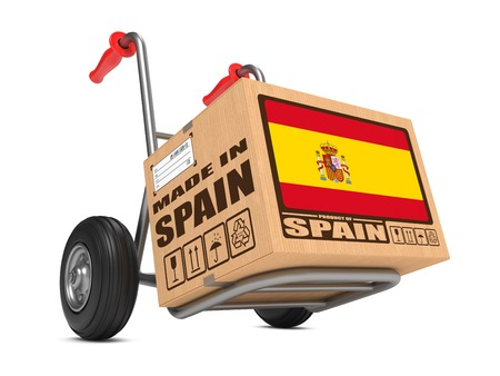 millboard: Cardboard Box with Flag of Spain and Made in Spain Slogan. Free Shipping Concept. Stock Photo