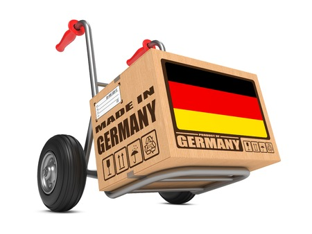 made in germany: Cardboard Box with Flag of Germany and Made in Germany Slogan. Free Shipping Concept. Stock Photo