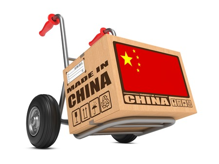 consignment: Cardboard Box with Flag of China and Made in China Slogan. Free Shipping Concept. Stock Photo