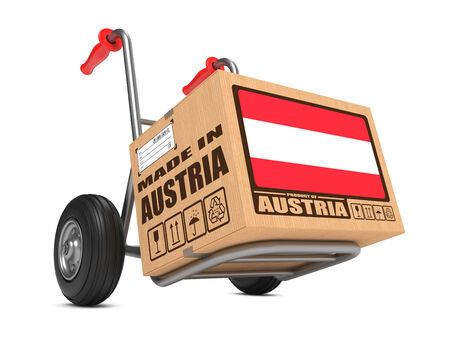 Cardboard Box with Flag of Austria and Made in Austria Slogan. Free Shipping Concept. photo