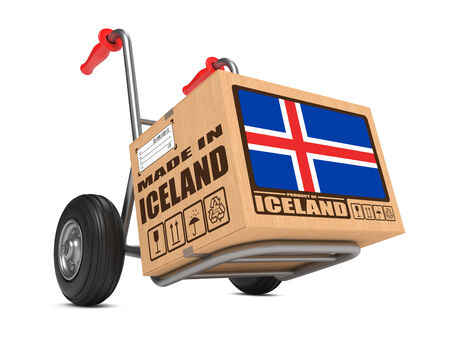 Cardboard Box with Flag of Iceland and Made in Iceland Slogan. Free Shipping Concept. photo