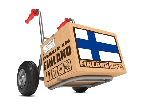 Cardboard Box with Flag of Finland and Made in Finland Slogan. Free Shipping Concept. photo