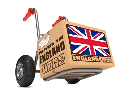 consignment: Cardboard Box with Flag of United Kingdom and Made in England Slogan. Free Shipping Concept.