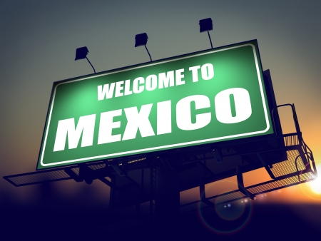 Welcome to Mexico - Green Billboard on the Rising Sun Background. photo