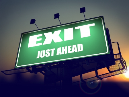 just ahead: Exit Just Ahead - Green Billboard on the Rising Sun Background.
