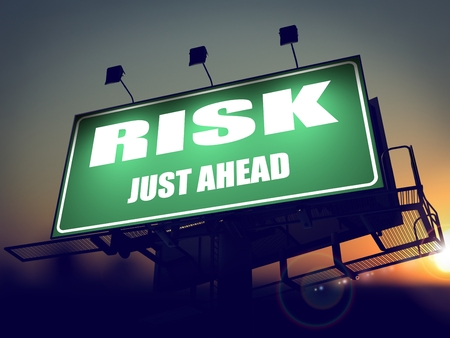 Risk Just Ahead - Green Billboard on the Rising Sun Background. photo