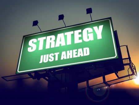 just ahead: Strategy Just Ahead - Green Billboard on the Rising Sun Background.