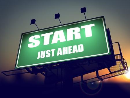 just ahead: Start Just Ahead - Green Billboard on the Rising Sun Background.