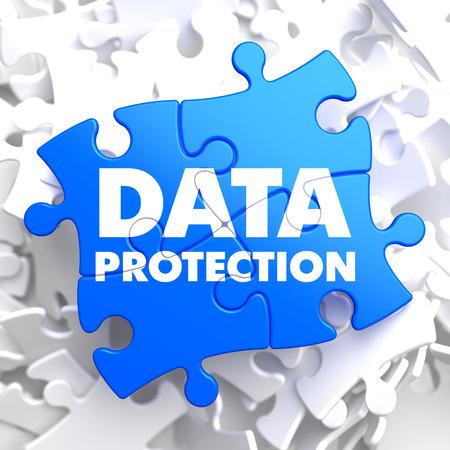 Data Protection on Blue Puzzle on White Background. photo