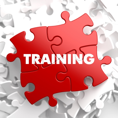 management training: Training on Red Puzzle Pieces. Educational Concept. Stock Photo