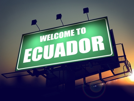 Welcome to Ecuador - Green Billboard on the Rising Sun Background. photo