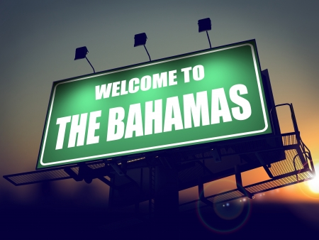 Welcome to the Bahamas - Green Billboard on the Rising Sun Background. photo