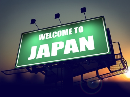 Welcome to Japan - Green Billboard on the Rising Sun Background. photo