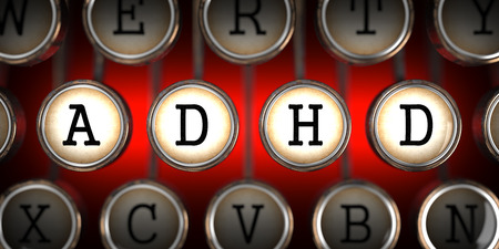 ADHD on Old Typewriters Keys on Red Background. photo
