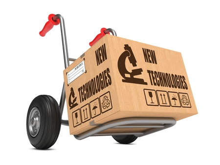 New Technologies Slogan on Cardboard Box on Hand Truck White Background.