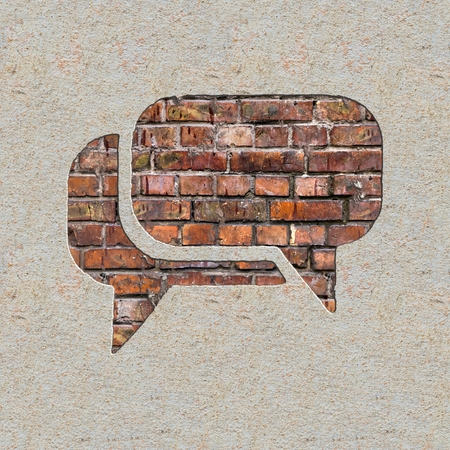 Speech Bubble Icon on the Brick and Plastered Wall. photo