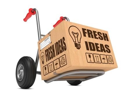 Fresh Ideas Slogan on Cardboard Box on Hand Truck White Background.