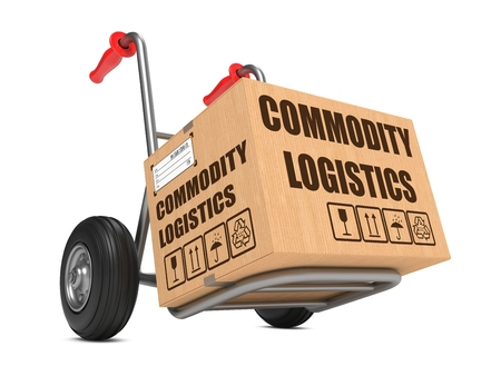 Cardboard Box with Commodity Logistics on Hand Truck White Background. Stock Photo