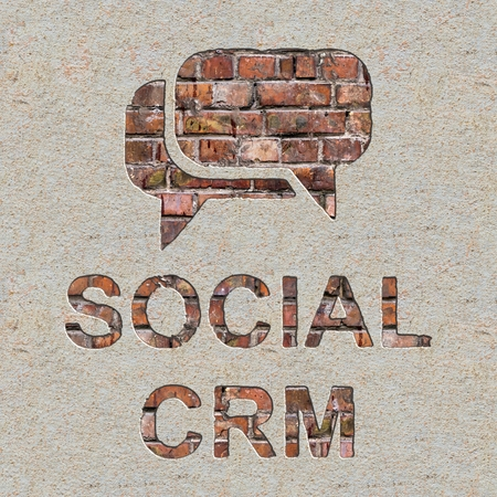 Social CRM Concept  with Speech Bubble Icon on the Brick and Plastered Wall. photo