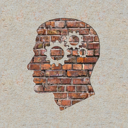 Psychological Concept - Profile of Head with Cogwheel Gear Mechanism on the Brick and Plastered Wall. photo