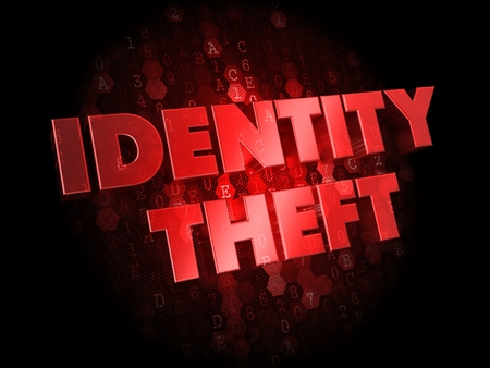 Identity Theft - Red Color Text on Dark Digital Background. photo