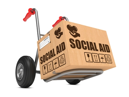 clemency: Social Aid Slogan on Cardboard Box on Hand Truck White Background.
