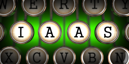 IAAS on Old Typewriter's Keys on Green Background. photo