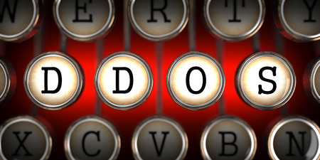 distributed: DDOS on Old Typewriters Keys on Red Background.